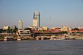 Tour boats and city skyline, Phnom Penh, Cambodia, Asia