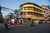 Street scene with mopeds, Phnom Penh, Cambodia, Asia