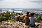 Couple looks out over rice fields near Vietnam and Cambodia border from Long Son Pagoda on Sam Mountain, near Chau Doc, An Giang, Vietnam, Asia