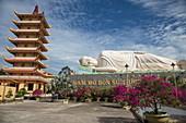 Giant reclining Buddha statue at the Vinh Trang Pagoda, My Tho, Tien Giang, Vietnam, Asia