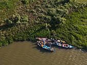 Aerial view of fishermen on a group of longtail boats along the banks of the Tonle Sap River, near Kampong Chhnang, Kampong Chhnang, Cambodia, Asia