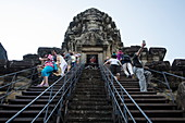 Visitors climb steep stairs at the Angkor Wat temple, Angkor Wat, near Siem Reap, Siem Reap Province, Cambodia, Asia