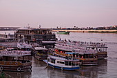 river cruise ship and tour boats moored at Phnom Penh floating port at sunset, Phnom Penh, Cambodia, Asia