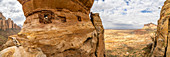 Aerial panoramic by drone of priest looking out from Abuna Yemata Guh rock-hewn church, Gheralta Mountains, Tigray region, Ethiopia, Africa