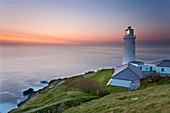 A peaceful dusk on Cornwall's Atlantic coast, showing the lighthouse at Trevose Head, near Padstow, Cornwall, England, United Kingdom, Europe