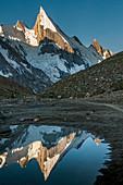 Laila Peak in the Hushe Valley, reflected in small pond in the valley at sunrise, Karakoram range, Gilgit-Baltistan, Pakistan, Asia