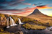 Sunrise at Kirkjufell Mountain overlooking a small waterfall, Iceland, Polar Regions