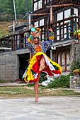 Bhutanese people performing the masked Cham Dance, Paro, Bhutan, Asia