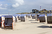 Beach chairs in the wind, beach, sand blowing, North Sea, Norderney, East Frisia, Lower Saxony, Germany