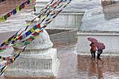 Monsoon rains at the stupa of Bodnath, Kathmandu, Nepal, Asia.