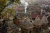 Smoke rises from the cremation sites in Pashupatinath, Kathmandu, Nepal, Asia.