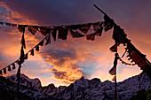 Sunrise and prayer flags at Annapurna Base Camp, Nepal, Himalayas, Asia.
