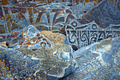 Buddhist mantra on a Mani wall, Manang Valley, Nepal, Himalaya, Asia.