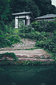 Traditional Japanese architecture in Kamakura with pond in the foreground, Tokyo, Japan