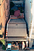 A bird's eye view of a textiles shop in Kyoto with a small delivery truck, Japan