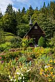 Wooden chapel and cottage garden, near St Märgen, Black Forest, Baden-Württemberg, Germany