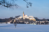Andechs Monastery in a snowy winter landscape, Andechs, Bavaria, Germany.