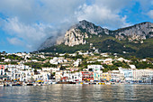View from sea at the Marina Grande and mountain in Capri, Italy