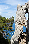 Detail of Arco Naturale and view at sea in Capri, Italy