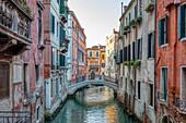 """Small, white bridge over the """"Rio de la Barcaroli"""" for pedestrians, Venice, Veneto, Italy"""