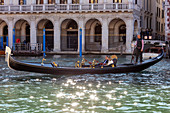 Godel with guests in the Grand Canal in Venice, Veneto, Italy