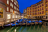 Resting gondolas at Bacino Orseolo in Venice before sunrise, Veneto, Italy