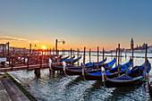 Gondola in front of Riva degli Schiavoni with San Giorgio in the background (right) in Venice, Veneto, Italy