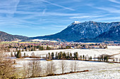 Inzell in winter in the midday sun with snow, Bavaria, Germany