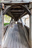 Wooden bridge over the fortification ditch of the Spitalbastei of Rothenburg ob der Tauber, Middle Franconia, Bavaria, Germany