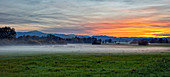 Field with ground fog at sunset near Bad Aibling, Panorama, Bavaria, Germany