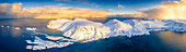 Arctic sunrise on snow capped mountains and cold sea, aerial view, Sorvaer, Soroya Island, Troms og Finnmark, Arctic, Norway, Scandinavia, Europe