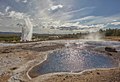An Icelandic icon, a hot pool with Strokkur Geysir behind, at Geysir, Iceland, Polar Regions