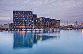 An evening view of the modern Harpa Concert Hall, beside the old harbour in Reykjavik, southwest Iceland, Polar Regions