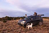 children on SUV at sunset, Galisteo Basin, Santa Fe