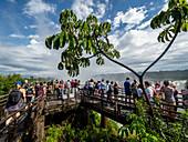 Visitors on the platform at Devil's Throat (Garganta del Diablo), Iguacu Falls, UNESCO World Heritage Site, Misiones Province, Argentina, South America