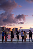 People watching sunset from Harbour City, Hong Kong, China, Asia