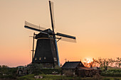 Windmill at sunset, Kinderdijk, UNESCO World Heritage Site, South Holland, Netherlands, Europe