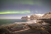 Devil's teeth Mountain illuminated by moon and Northern Lights, Tungeneset, Senja, Tromso, Norway, Europe