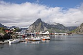 Little bay and peaks of Hamnøy, Moskenes, Nordland county, Lofoten Islands, Northern Norway, Europe