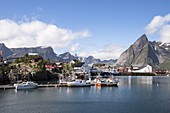Little bay and peaks of Hamnøy, Moskenes, Nordland county, Lofoten Islands, Northern Norway, Europe