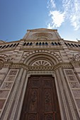 the door of the Cathedral of San Lorenzo, in the historic center of Grosseto, taken up on a summer morning, municipality of Grosseto, Grosseto province, Tuscany district, Italy, Europe