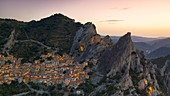 aerial view taken by drone of the village of Castelmezzano during a golden hours in summer time, with the Lucanian Dolomites in the background, municipality of Castelmezzano, Potenza province, Basilicata district, southern Italy, Europe