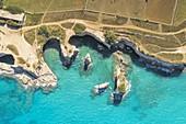 aerial view of the Faraglioni di Sant'Andrea in summer time, located along the Adriatic coast, municipality of Meledugno, Lecce province, Apulia district, Italy, Europe