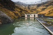 Iceland, Sudurland, Seljavallalaug.\nSeljavallalaug is natural spa on Sudurland region of Iceland. The thermal water are free access