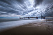 Long exposure on a cloudy day at the pier of Marina di Pietrasanta, Lucca province, Versilia, Tuscany, Italy, Europe