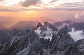 Sunsetscape over Catinaccio peaks during summer over mountains. Fassa valley, Trento district, Dolomites, Trentino Alto Adige, Italy, Europe.