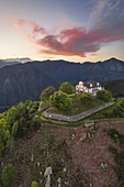 The Sanctuary of San Bernardo at sunset, in the background the Monte Rosa (Oasi Zegna natural area, Valdilana, Biella province, Piedmont, Italy, Europe)