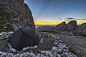 A tent at Vajolet Towers during sunset, Catinaccio Group, Dolomiti di Gardena e di Fassa, Bozen, Trentino Alto Adige, Italy, Southern Europe