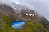 Aerial view of Vago lake during misty summer morning, Livigno, Lombardy, Italy, Southern Europe