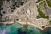 Aerial view of the ruins fo the ancient Phoenician city of Tharros, Capo San Marco, Sinis peninsula, Cabras, Oristano province, Sardinia, Italy.
